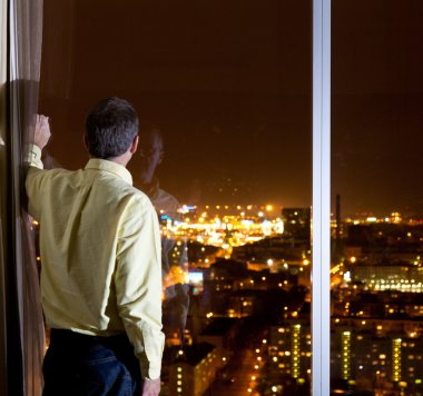 Man looking over city
