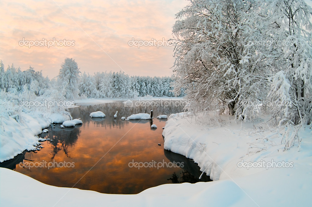 Unfrozen lake in the winter forests
