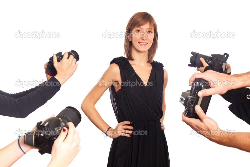 Celebrity Woman in front of Paparazzi stock vector