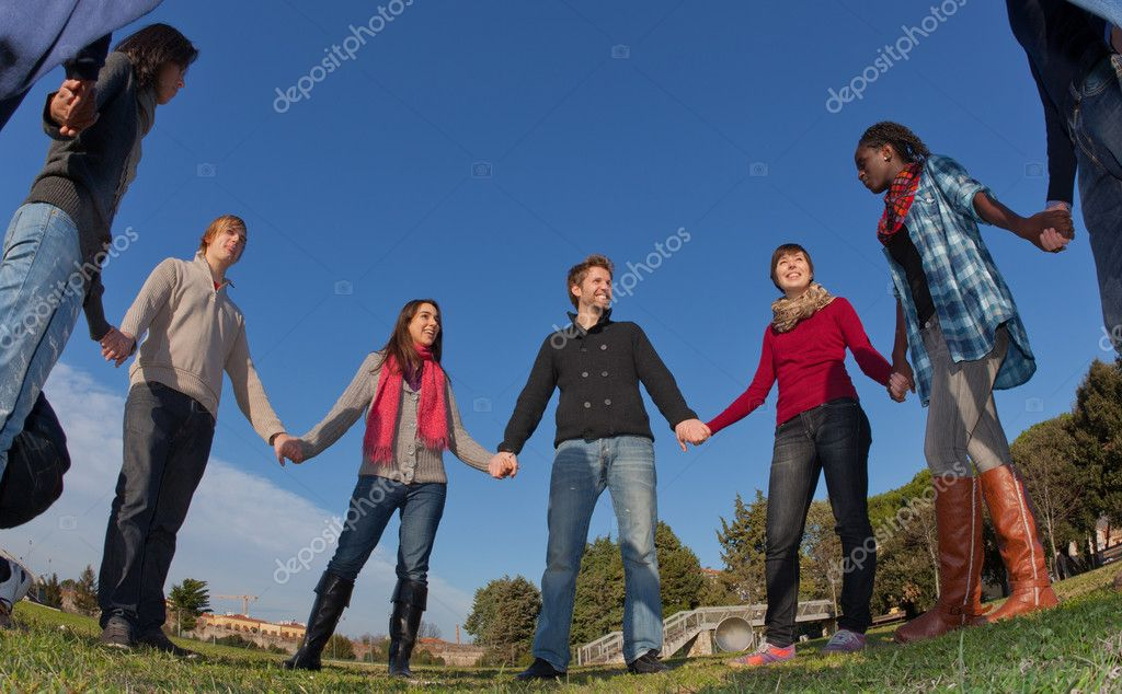 Multiracial Young Holding Hands in a Circle