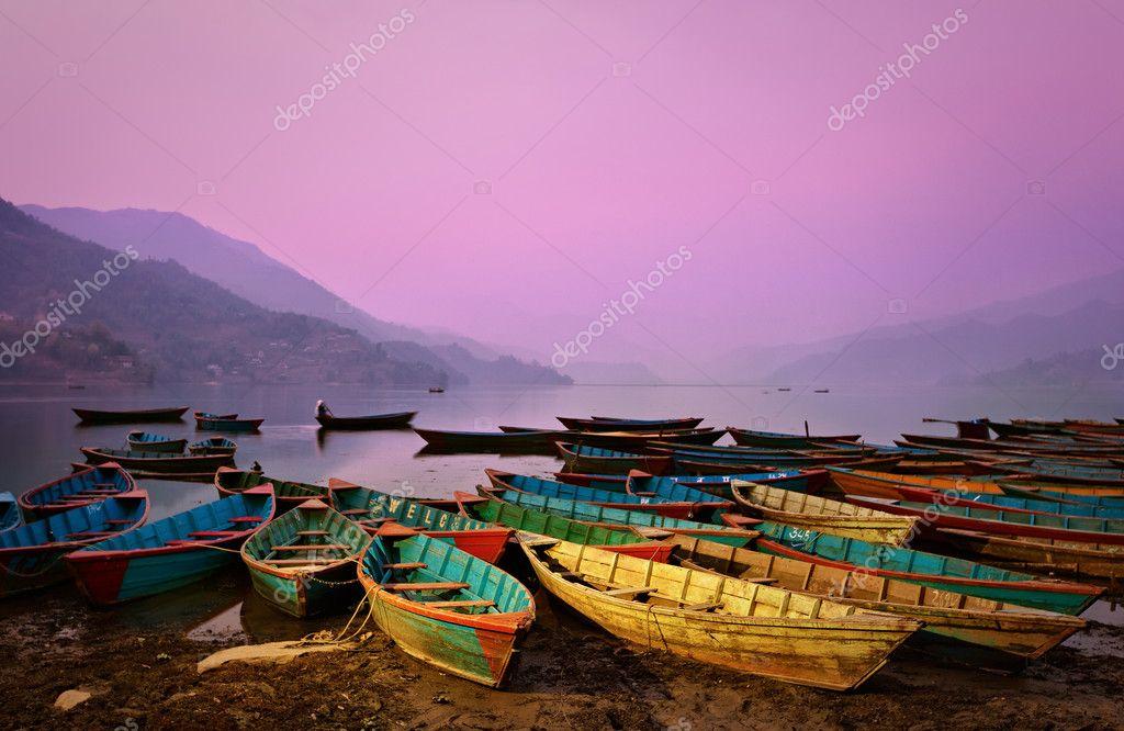 Beautiful twilight landscape with boats on Phewa lake, Pokhara,