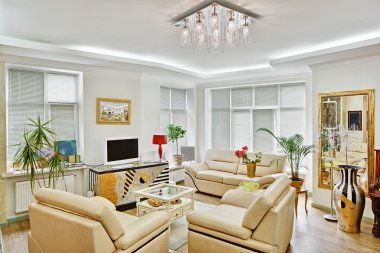 Modern art deco style drawing-room interior with beige leather f