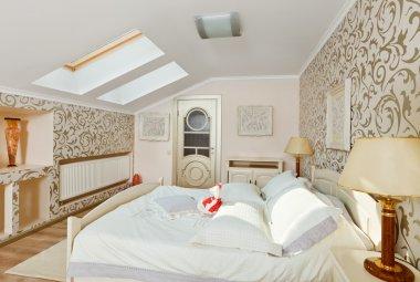 Modern art deco style bedroom interior in light beige colors on