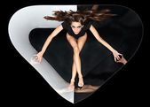 Fotografie Young slim beautiful lady with long hairs running in abstract pl