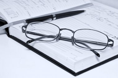 Pen glasses and notebook