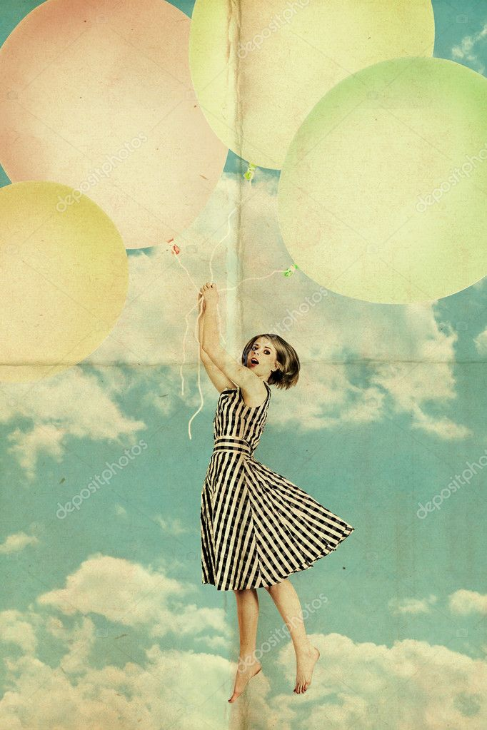 Woman on air balls in blue sky with clouds
