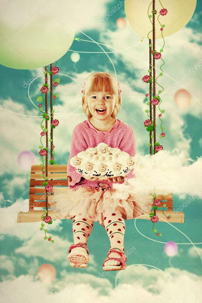 Little girl on the swing in the sky