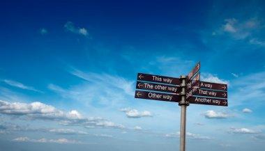 Signpost in sky