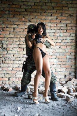 Soldier taking frightened woman in underwear hostage stock vector