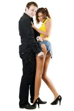 Man rending shorts of woman