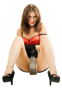 Pretty woman with a bottle between her legs