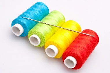 Multi-colored rainbow threads for sewing with needle stock vector
