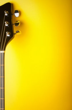 Guitar on a yellow background