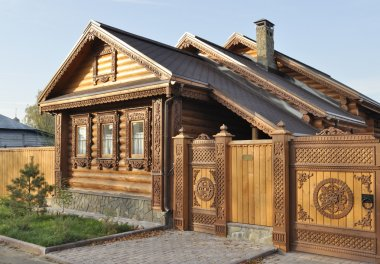 Beautiful wooden house with carved front