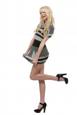 Beautiful young blonde woman wearing striped dress and black hig