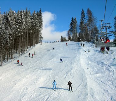 Ski track with chair lift in the mountains