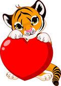 Fotografie Cute tiger cub holding heart
