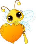 Fotografia ape carino tenendo un dolce cuore