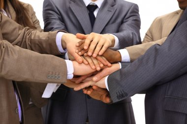 Closeup of business with their hands together against a black backgr