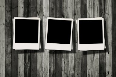 Blank Polaroids on Wood Background