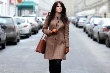 Beautiful young woman walking on the street