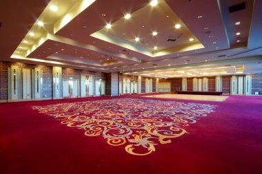 Huge Hall interior with red carpet and seiling with lights in Hotel