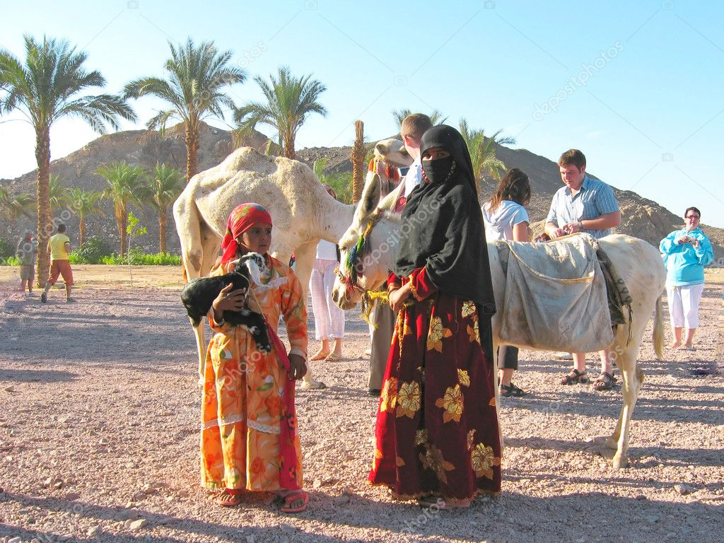 Bedouin woman with a child