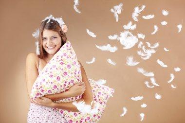 Girl holding pillow