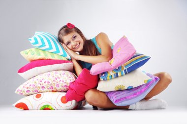 Girl restion on pillows