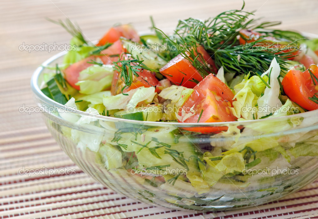 Fresh vegetable salad with tomato, lettuce, cucumber Fresh vegetable salad