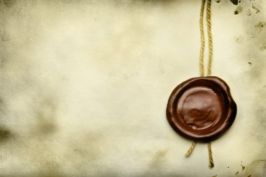Old paper with wax seal close up