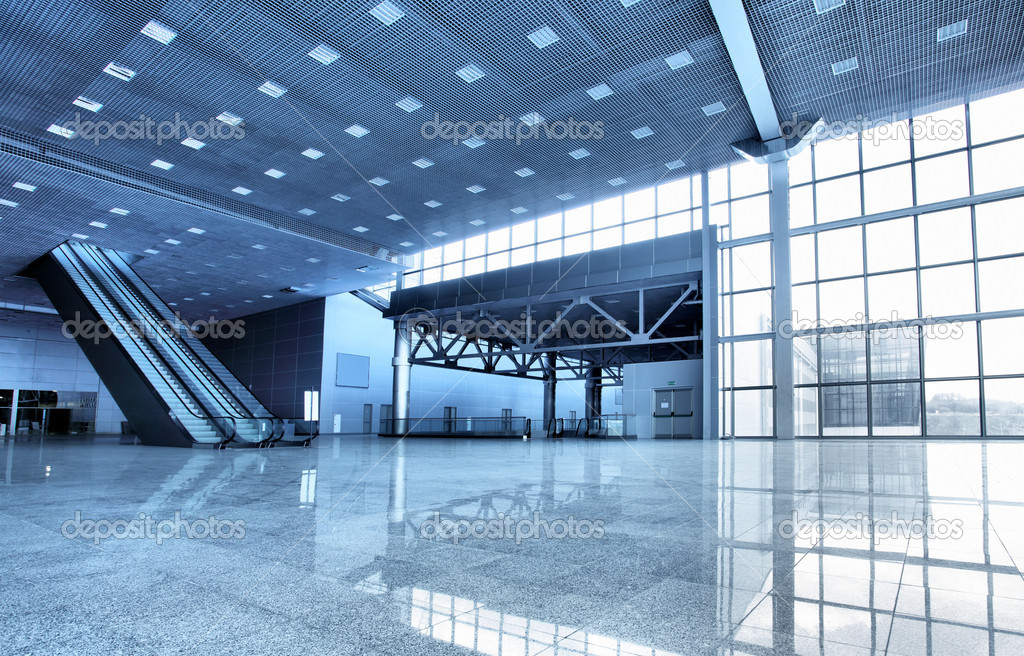 Large modern hall with windows and escalator stock vector