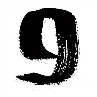 9 - Black ink numbers over the white background