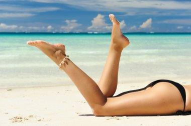 Women's legs on a beach