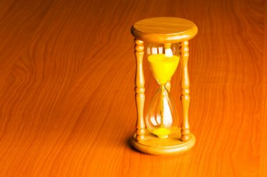Time concept with hourglass against background
