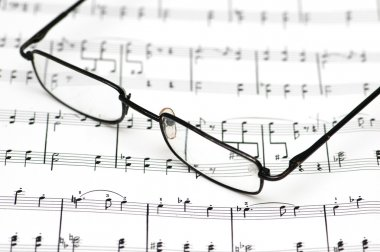 Reading glasses over the music sheets