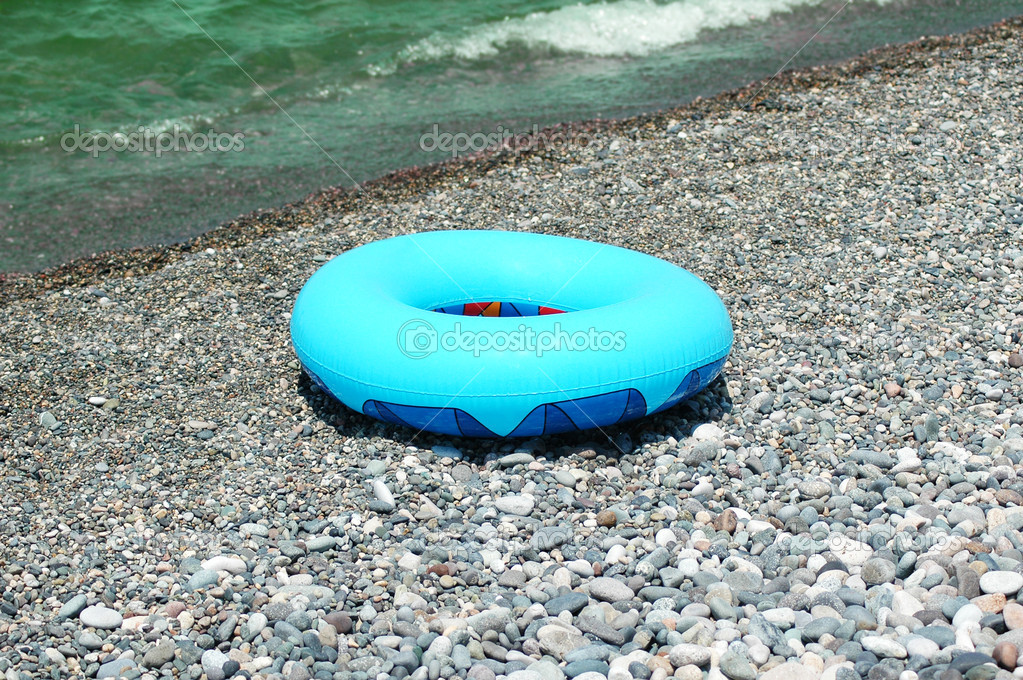 Ring buoy on the beach in summer