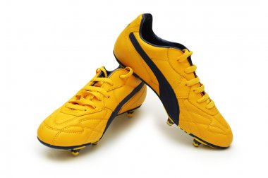 Yellow football boots isolated on the white