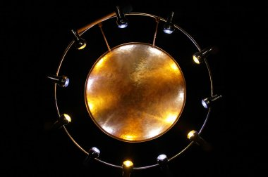Metal gong against the black background