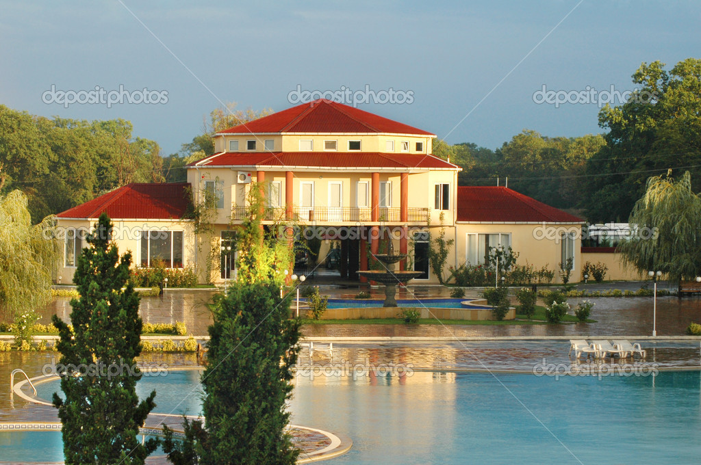 Big Summer House With Swimming Pool In Summer Stock Photo