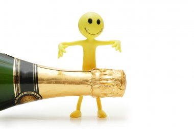 Bottle of champagne and figure of Smiley
