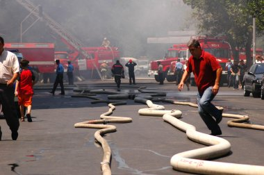 Fire hoses stretching across the street during fire