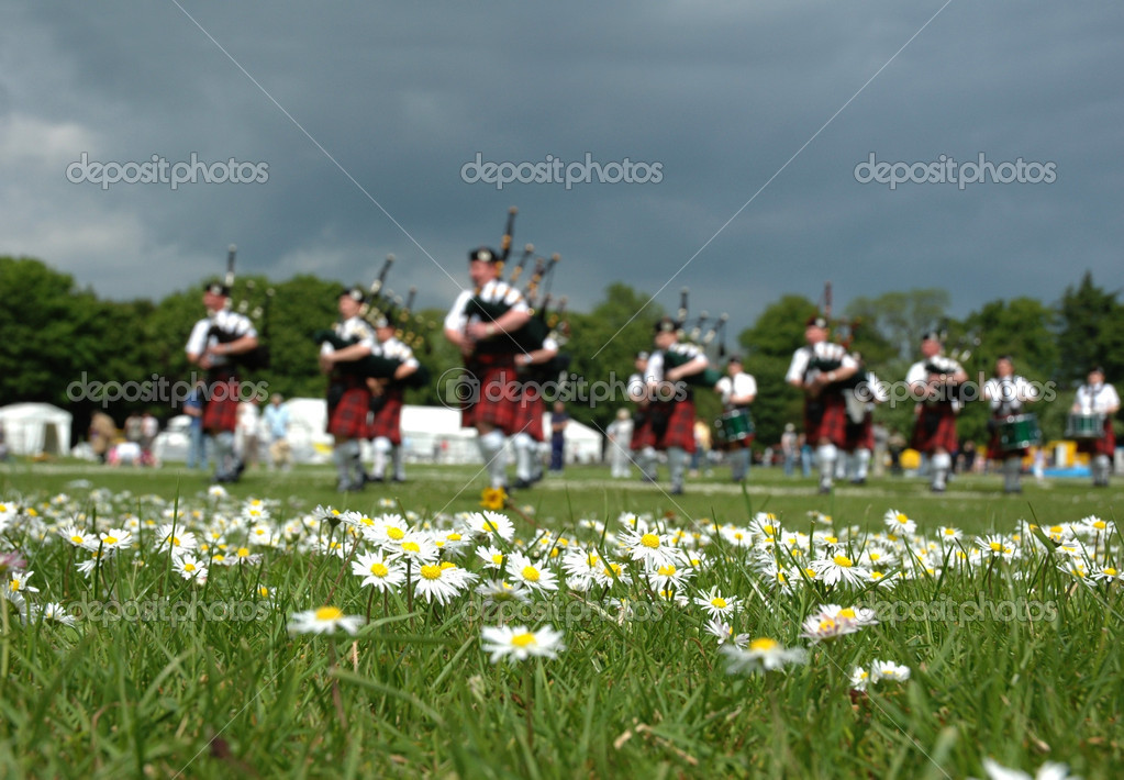 Scottish Pipe Band marching on the grass
