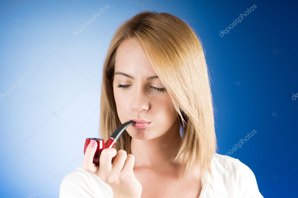 girl smoking pipe against the gradient background stock photo