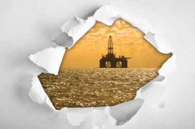 Oil platform through hole in paper