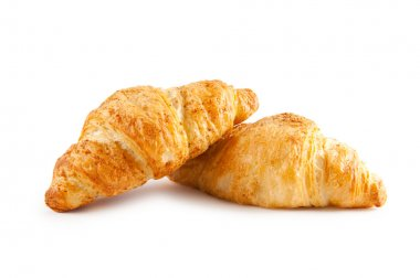 Breakfast concept - croissant isolated on white