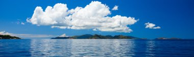Panorama of tropical islands and big cloud