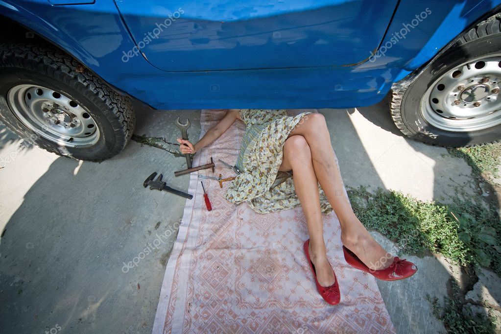 Vintage girl with tools under car — Stock Photo © aragami12345 #3999152
