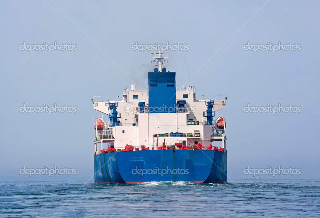 Aft of tanker sailing in the sea with water splashes