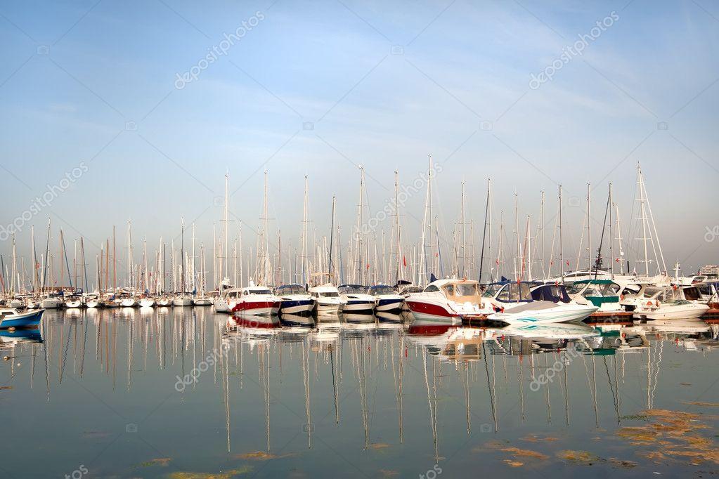 Sailing boats in marine at sunrise
